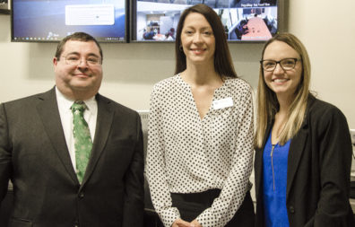 Robert Playo, left, with Clinical Assistant Professor Dana Dermody, center, and Megan Weese, right, at the presentation of DNP final projects.