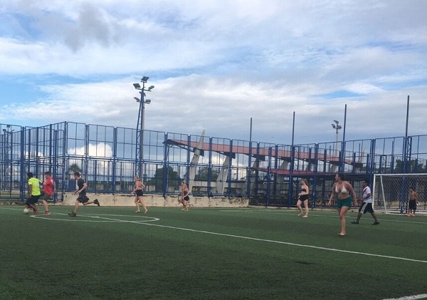 students and others playing soccer