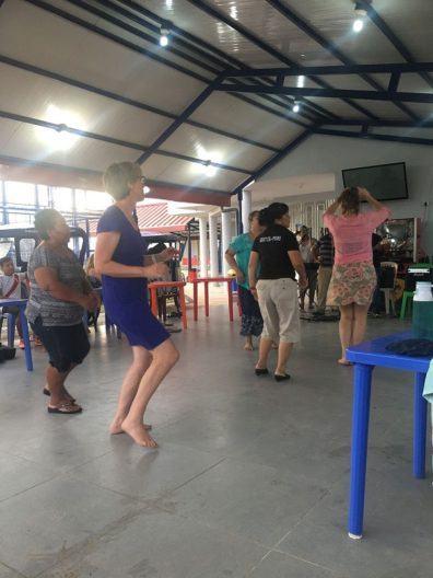 People dancing in a covered pavilion