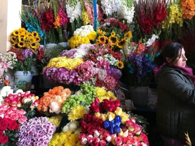 flowers in a market stand