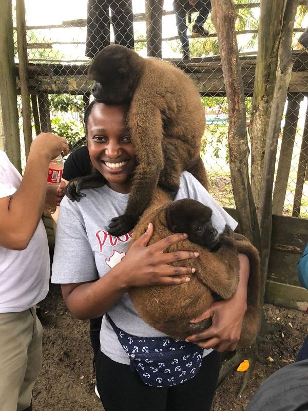 Woman holding two monkeys