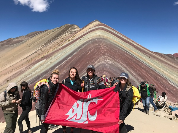 Four students at the top of a mountain