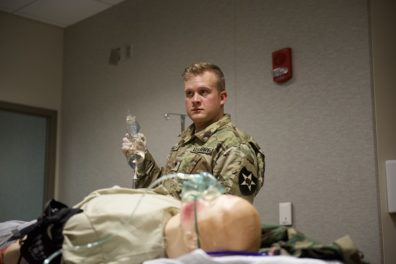 army specialist with IV bag
