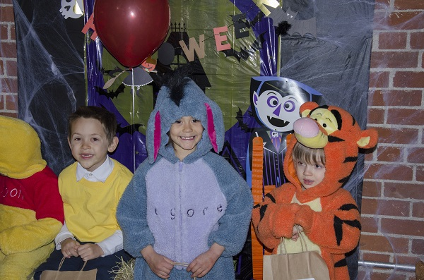 three kids in costume