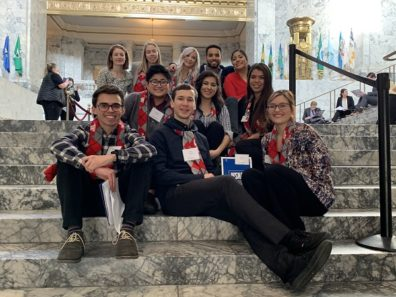 small group shot on interior steps in Capitol rotunda.