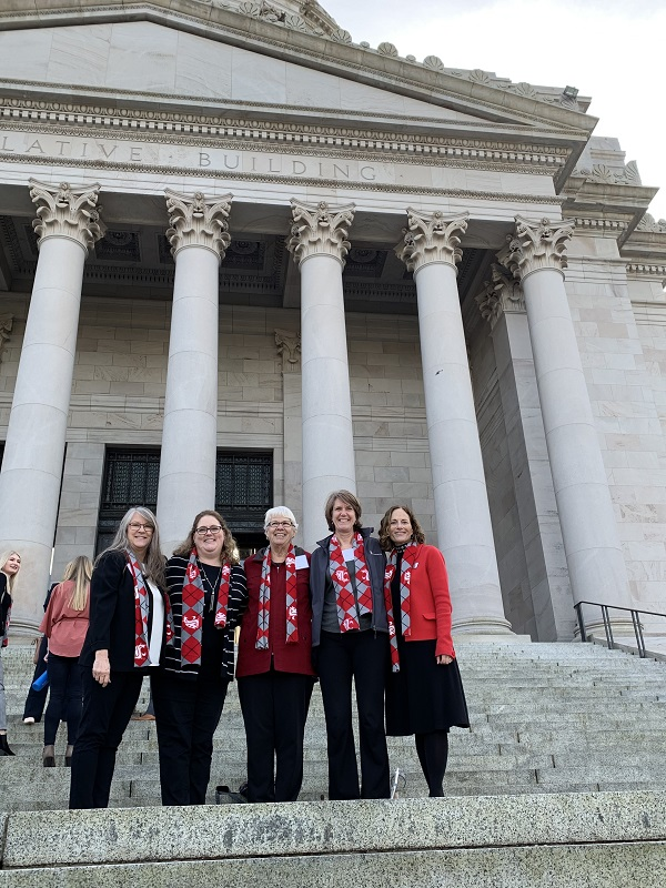 Five faculty members on the steps of the Capitol
