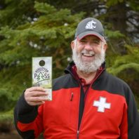 Portrait of a man holding a Discover Pass