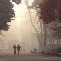 two people walking on a college campus during wildfire smoky season