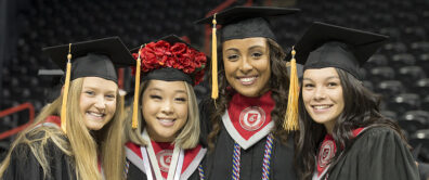 four female graduates