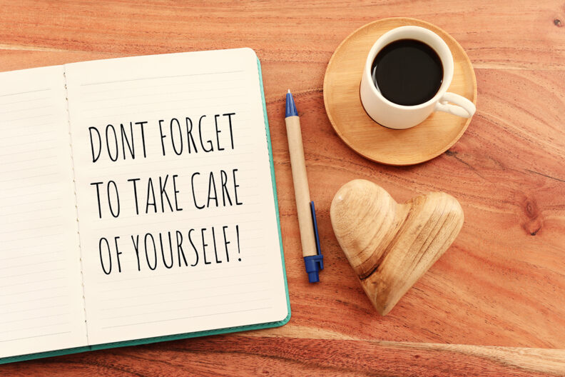Notebook with self care notes in it