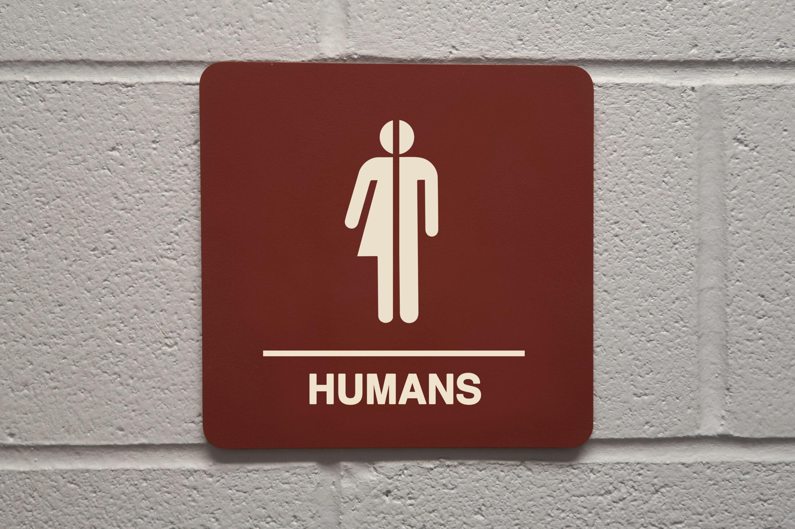 Close up of gender neutral restroom sign