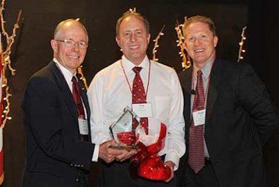Greg Gibbons winning outstanding alumnus of the year