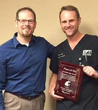 dr. varga accepts award