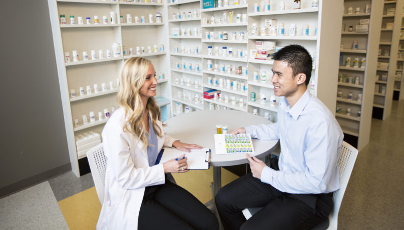 Student pharmacist counseling a patient about their medication.