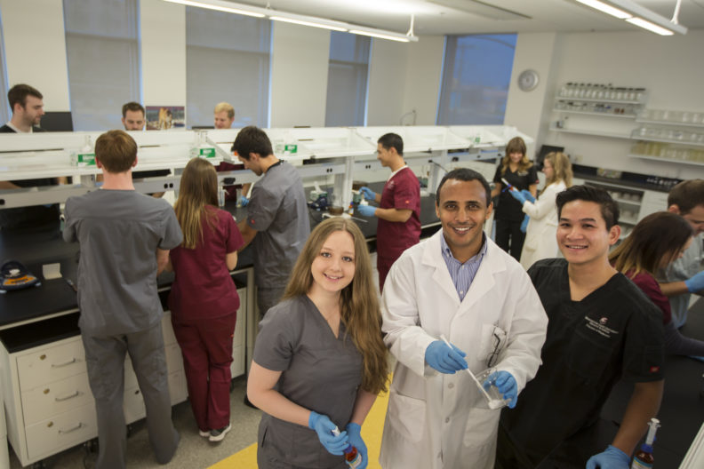 College of Pharmacy students working together in the compounding lab.
