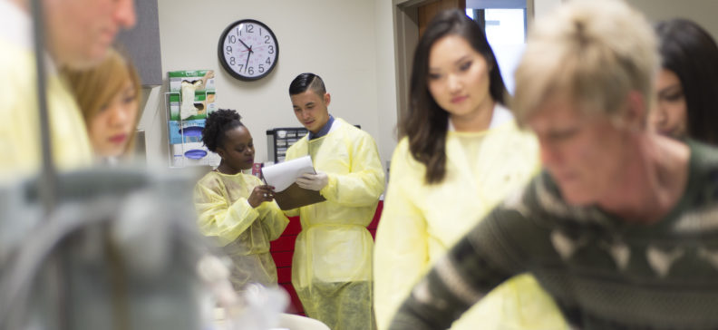 Student pharmacists working as a team in a hospital simulation.