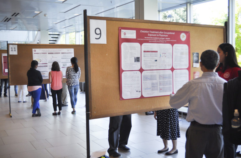 Students presenting research posters