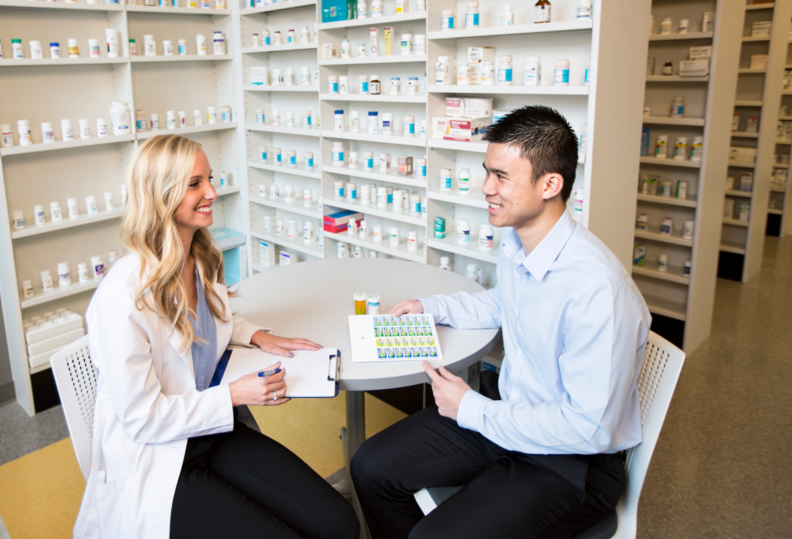 Student pharmacist counseling a patient