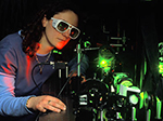 Physics student works with laser in lab