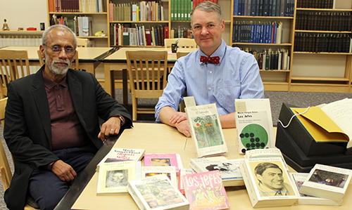 Francisco Manzo-Robledo and Trevor Bond with several books by Mario Vargas Llosa, WSU writer-in-residence 1968-69, that were in the late Wolfgang Luchting's library. (Photo by Nella Letizia, WSU Libraries)