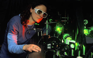 Physics student working with laser in physics lab