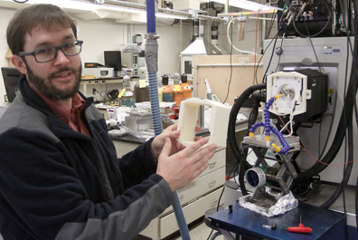 Brian Clowers employed Tech Services' new 3D printer to make a protective casing for a mass spectrometer in his lab.
