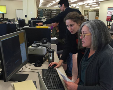 CDSC staff assist members of the tribal stewardship cohort with their digital curation projects.