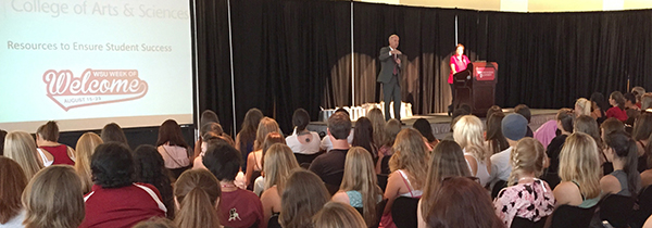 DeWald speaks with freshmen at the college's 2015 Week of Welcome kickoff event.