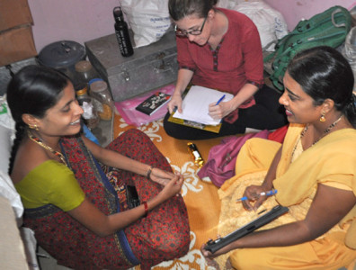 Placek and her research assistant interview a pregnant woman about dietary cravings and aversions in South India.