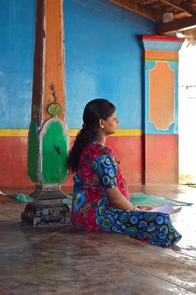 A pregnant woman meditates in Tamil Nadu.