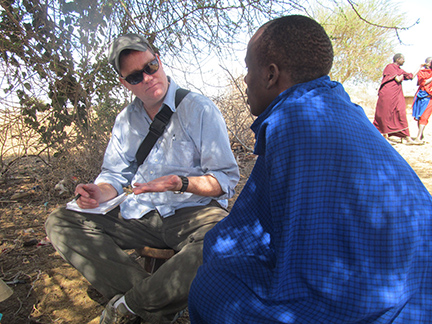 Rob Quinlan, associate professor of anthropology, interviews Il Simanjiro Maasai tribesmen about livestock management and environmental risk in northern Tanzania.