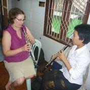 McCarthy working with a student in Yangon, Burma