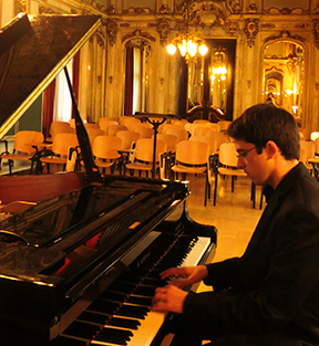 McElroy playing piano in the ballroom of the 18th-century Palais Corbelli in Vienna