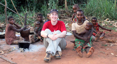 Meehan, center, visits with a family in the Central African Republic.