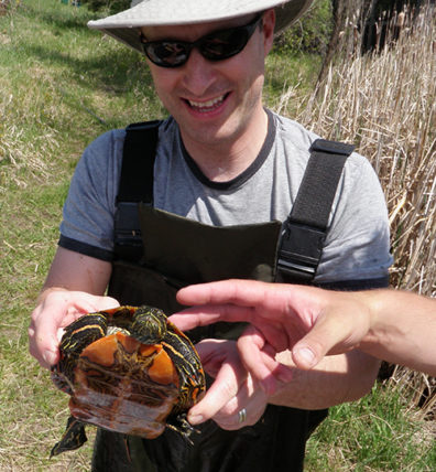 Jesse Brunner holds a painted turtle