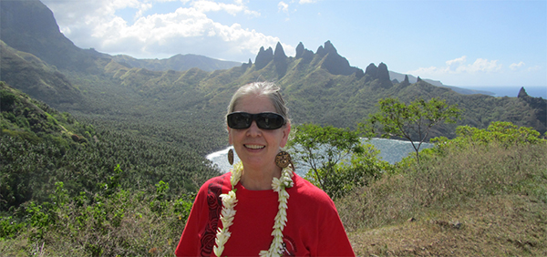 Carol Ivory with mountains in the background