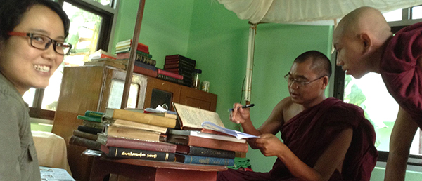 Khine Nyein Aye (left), a graduate student at Mandalay University in Burma and Cassaniti's research assistant, interviews monks at a Buddhist monastery outside of Mandalay, Burma.