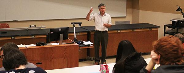 Cerruti teaches a class of Physics 201 students.