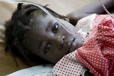 Francina Devariste lies in a hospital bed in Dessalines, Haiti. She was one of more than 530,000 individuals affected by a massive cholera outbreak in Haiti in 2010-2012. Photo: UN Photo/UNICEF by Marco Dormino