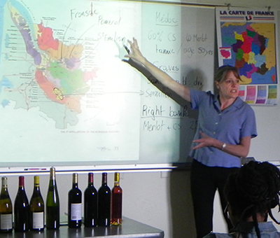 Sabine Davis points to a map of France to explain the different wine-making regions.