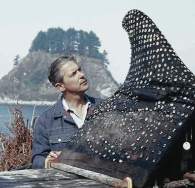 In this undated WSU photo, Daugherty stands by the effigy of a whale fin unearthed at the Ozette site.