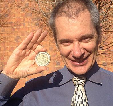 Tom Gazzola with coin award