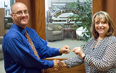 Wiest (right) hands over the DFLC office key to Hughes.