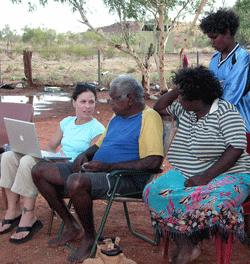Kim Christen demonstrates digital archiving  to members of the Warumungu Aboriginal community  in Australia's Northern Territory.