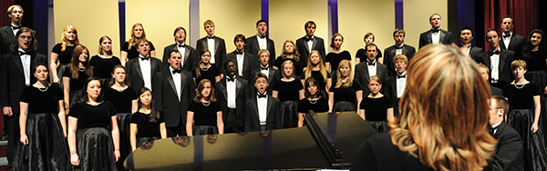 Wiest, right foreground, conducts the WSU Concert Choir during a performance in Bryan Hall Auditorium.