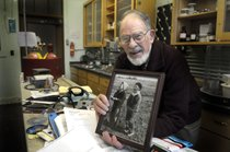 Don Matteson holds a 1937 photo of himself and the girl who became his wife, Marianna, in his lab at WSU's Fulmer Hall. (Photo by Christopher Anderson/ Spokesman Review 2008. Read the accompanying story)