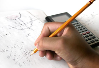 pencil in hand doing arithmetic