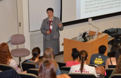 Noel Schultz, professor of engineering and WSU first lady, addresses a WiSTEM Wednesday crowd.