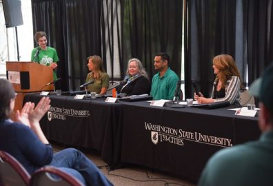 Elinor Lake addresses a panel at Earth Day.