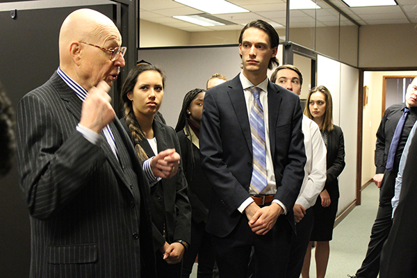 WSU alumnus Judge John Rossmeissl enthusiastically makes a point while talking with the Mock Trial Team.
